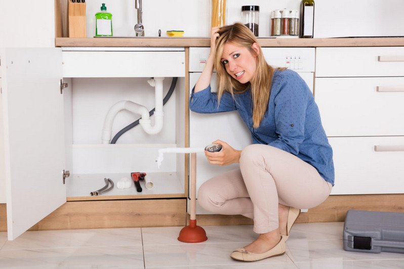 woman having plumbing problems with her sink diy